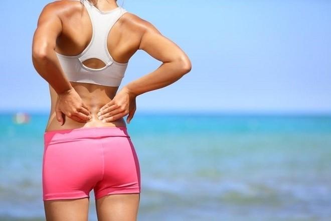đau lưng cản trở quá trình tập luyện thể dục