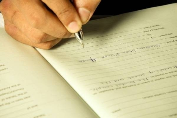 25384-16-signing-the-marriage-register.jpg