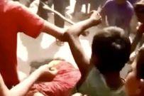 Bà vợ bị 25 người đàn ông đánh đập đến bất tỉnh sau khi bạo hành chồng đến chết