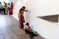 Sự thật phẫn nộ sau cảnh vợ phải kéo lê chồng bị liệt giữa bệnh viện